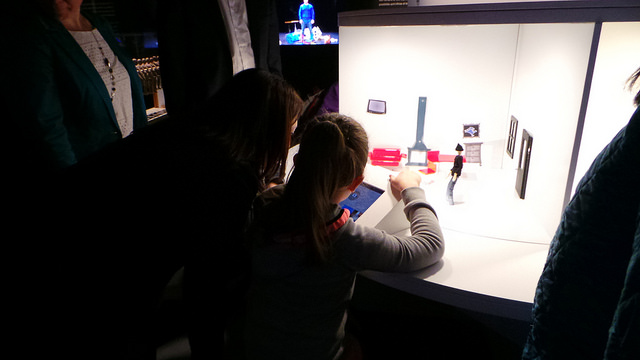 A curious youngster animates her characters at the museum.