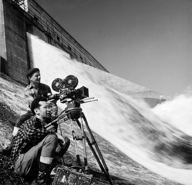 Morten Parker (foreground) and cameraman Ernie Wilson shoot a film on the Gatineau River in Quebec, June 1946. Photo: John Mailer.