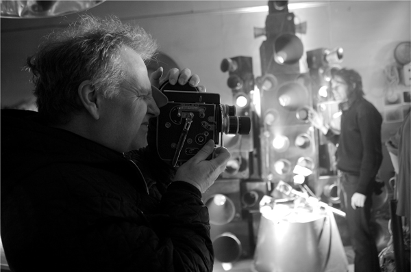 Guy Maddin shooting with a Bolex camera on the set of Night Mayor.