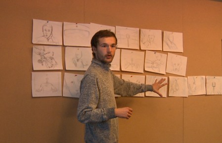 Alex Boya focused on his storyboard.