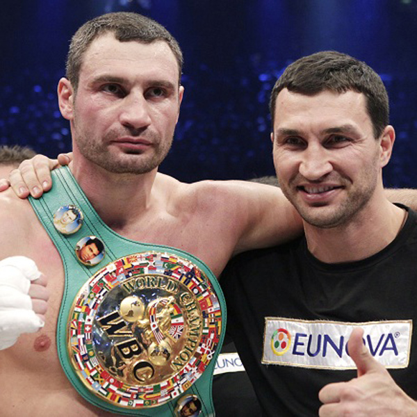 Champion Vitali Klitschko, left, of the Ukraine and his brother Wladimir pose for photo after defeating challenger Odlanier Solis of Cuba in the WBC heavyweight title bout to retain his championship in Cologne, Germany, Saturday, March 19, 2011. (AP Photo/Michael Probst)